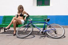 Woman With Bike Sitting Royalty Free Stock Photos