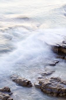 Free Wave Washing On Rocks Stock Photography - 5559532