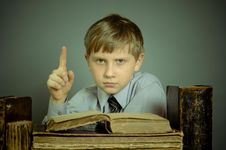 Free The Boy Spends Time Reading Old Books Royalty Free Stock Photography - 55579047