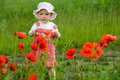 Free Baby-girl With Poppies Stock Image - 5561711