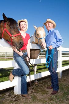 Free Two Farmers Smiling With Horses - Vertical Royalty Free Stock Photography - 5560047