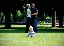 Baby Laughing While Parents Hug - Horizontal Stock Photography