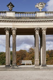Free Bench Between Columns Stock Image - 5562761