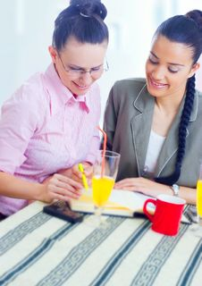 Free Two Young Businesswomen Working Stock Photography - 5564792