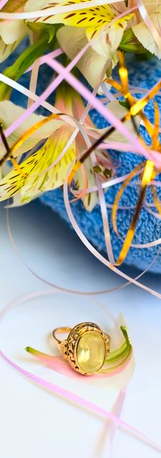 Free Flowers On Blue Fabric Background And Jewelry Royalty Free Stock Photo - 5567825