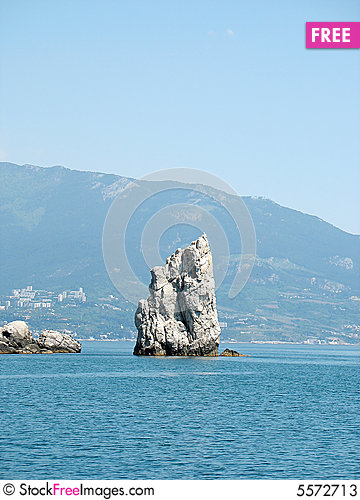 Free Isolated Rock In The Sea Stock Photos - 5572713