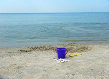 Free Bucket On Sea Shore Royalty Free Stock Photography - 5570737