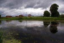 Village On The Pond Royalty Free Stock Image
