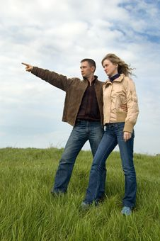 Guy And Girl In The Field Stock Photo