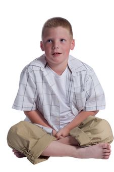 Free Little Boy Sitting And Thinking On White Backgroun Royalty Free Stock Images - 5575159