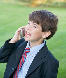 Free Little Boy Talking On Cell Royalty Free Stock Images - 5577719