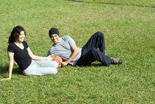 Free Man And Woman Sitting On Grass - Horizontal Stock Photos - 5579373
