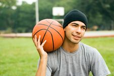 Free Man In Park Holding Basketball - Horizontal Stock Photos - 5579523