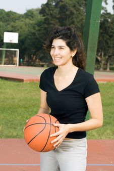 Free Woman Holding Basketball-Vertical Stock Photography - 5579592