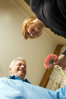 Free Older Couple Smiling Holding A Flower Royalty Free Stock Photos - 5579818