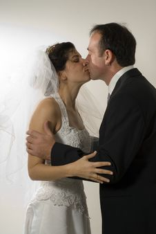 Free Newlyweds Kissing - Vertical Stock Images - 5579904