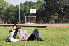 Free Man And Woman Laying Together In The Park - Royalty Free Stock Photos - 5579948