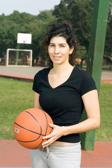 Woman Holding Basketball - Vertical Royalty Free Stock Image