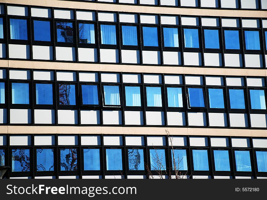 Modern Office Building with Window Reflections