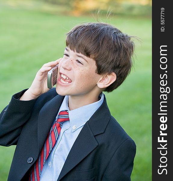 Little Boy Talking on Cell