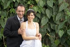 Free Newly Weds Smile At Camera - Horizontal Royalty Free Stock Photography - 5580037
