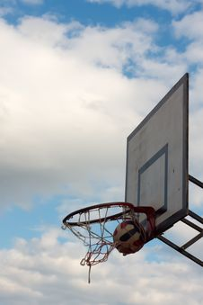 Ball In A Basketball Hoop Stock Image