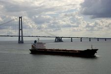Free Cargo Ship, Having Just Passed Under A Bridge Royalty Free Stock Photo - 5585645