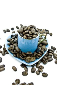 Free A Cup With Seeds Of Coffee Royalty Free Stock Photography - 5586267