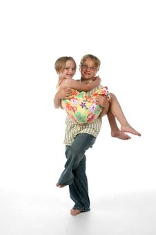 Big Brother Carrying His Younger Sister Royalty Free Stock Photo
