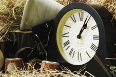 Clock And Paint Tins With Straw Royalty Free Stock Photography