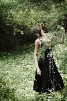 Girl In Black Dress In The Woods Stock Photos