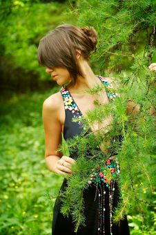 Free Young Girl In Black Dress In The Woods Royalty Free Stock Image - 5588916