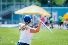 Free Girl Athlete Throwing Javelin Stock Photos - 55811893