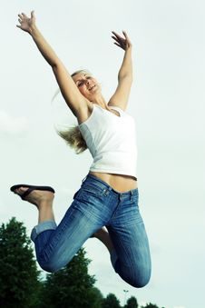 Free Happy Jumping Woman. Royalty Free Stock Photography - 5593637