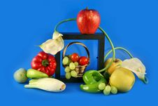 Composition From Vegetables And Flowers Royalty Free Stock Images