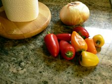 Free Peppers On Kitchen Counter 2 Stock Photos - 5596043
