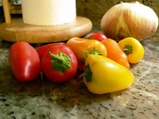 Free Peppers On Kitchen Counter 3 Royalty Free Stock Photo - 5596045