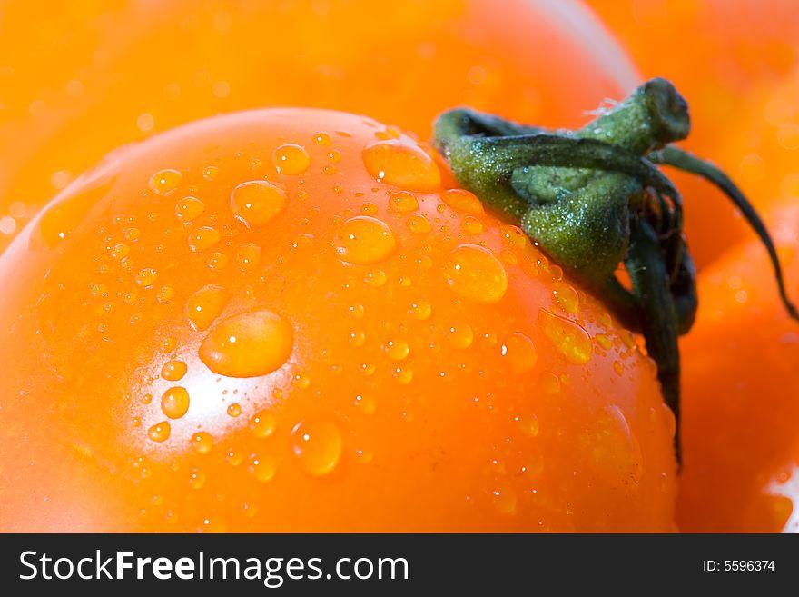 Closeup macro tomato with green shank