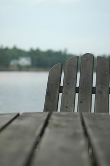 Adirondack Chair On Lake Stock Images