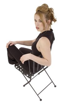 Free Glamorous Hispanic Woman In Black Iron Chair Stock Photos - 569013