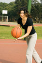 Free Woman Playing Basketball On Court-Vertical Royalty Free Stock Images - 5607659