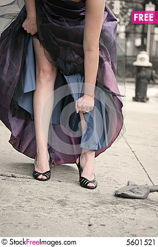 Free Woman Tearing Gown Stock Image - 5601521