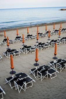 Free Closed Umbrellas On The Beach Stock Photos - 5601633