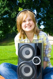 The Young Attractive Girl With Headphones Stock Photography