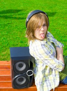 The Young Attractive Girl With Headphones Stock Photos