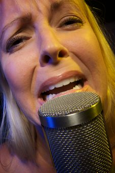 Free Woman Sings With Passion Stock Images - 5604974