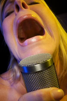 Free Woman Sings With Passion Royalty Free Stock Photos - 5605038
