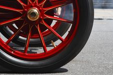 Free Retro Car Wheel Red On Road Stock Image - 5605981