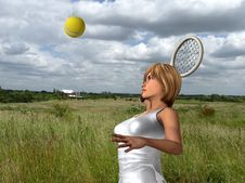 Free Women About To Hit Tennis Ball Royalty Free Stock Photos - 5607178