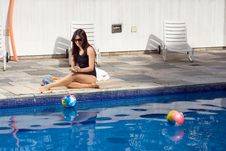 Free Female At Poolside - Horizontal Royalty Free Stock Images - 5607619